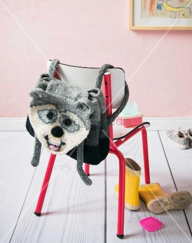 A homemade crocheted children's racoon rucksack made from felting wool
