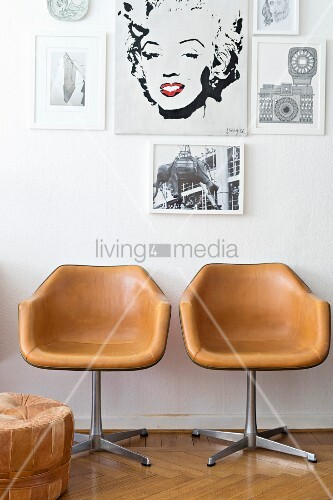 Gallery of pictures above two retro chairs covered in pale brown leather