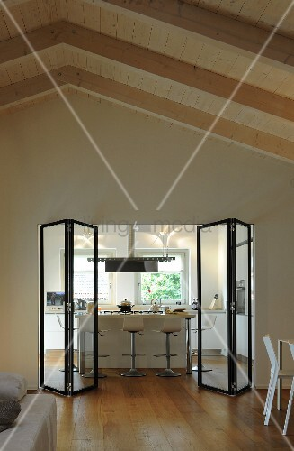 View into kitchen through modern glass folding doors