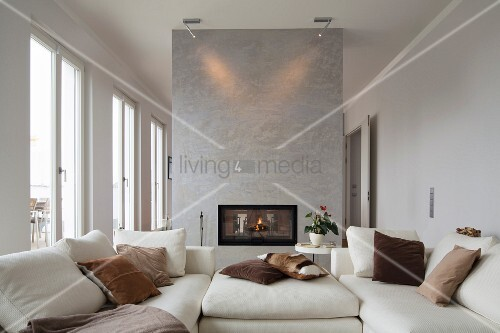 Interior of modern flat; living room with white couch