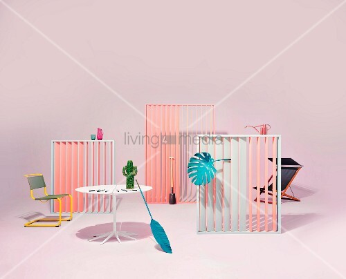 An arrangement of garden furniture and accessories in a pastel coloured studio