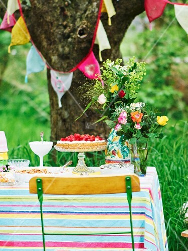 Various fruit cakes on garden table