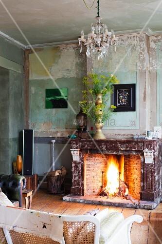 Open fire and flower arrangement in vintage interior
