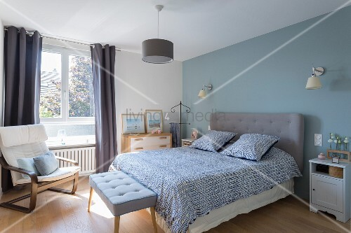Bedroom with pastel-blue accent wall and … – Buy image ...