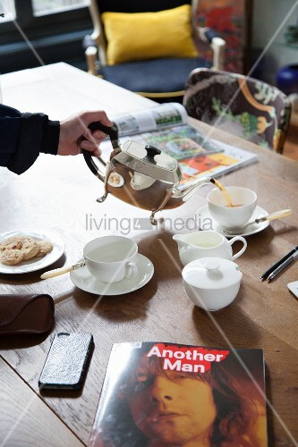 White tea set on oak table