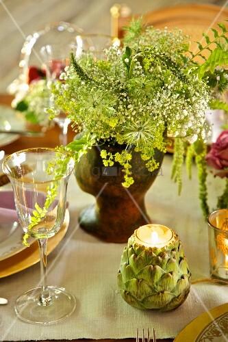 Artichoke-shaped tealight holder on festively set table