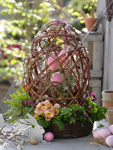 Wicker basket with egg made from Salix (kitten pasture) branches as decoration