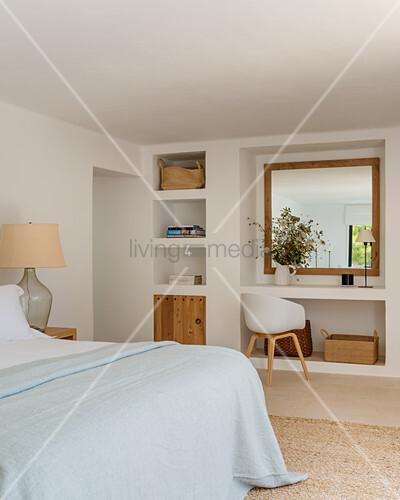 Masonry shelving in Mediterranean bedroom