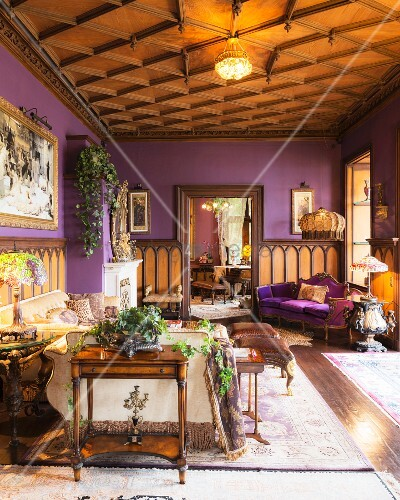 Coffered ceiling and lilac walls in living area