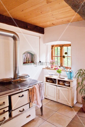 Wood-fired cooker and cabinet in country-house kitchen