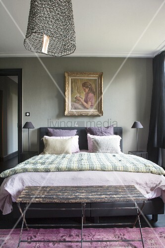 Gilt-framed painting in vintage-style bedroom