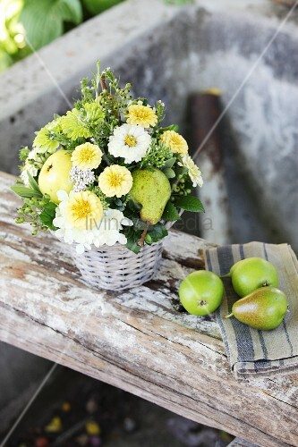 Arrangement of zinnias, hydrangeas and pears