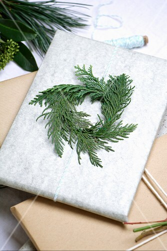 Christmas present decorated with circlet of thuja twigs