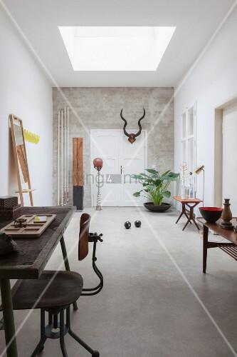 Spartan, retro room with skylight and concrete floor