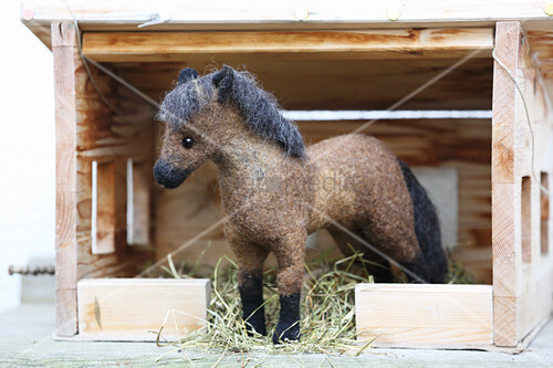 Hand-made, felted, woollen horse in miniature stable