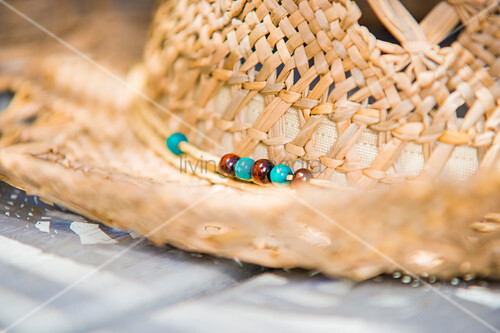 Detail of straw hat with bead detail