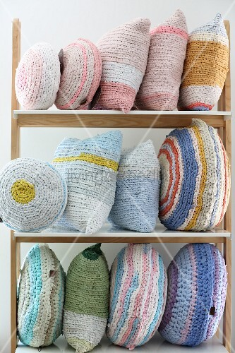 Various, crocheted, pastel cushions made from T-shirt yarn