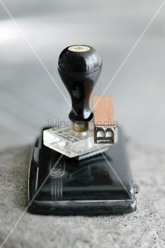 Black ink pad, stamp with handle and wooden stamp with letter B