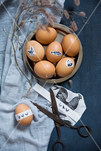 Vintage scissors and Easter eggs decorated with animal stickers