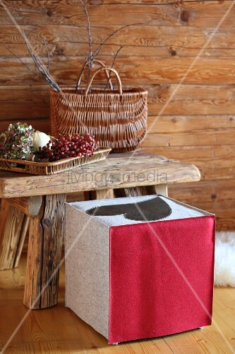 Stool with hand-made felt cover in rustic cabin-style interior