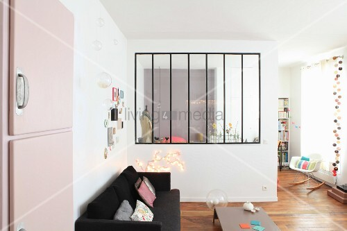 Partition wall with interior window in open-plan interior