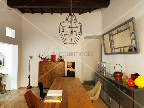 Wooden table and metal sideboard in designer dining room