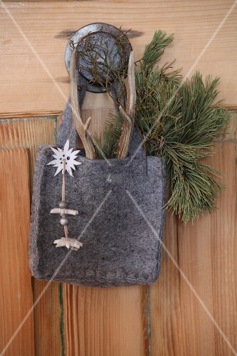 Felt bag decorated with Edelweiss and sprig of pine