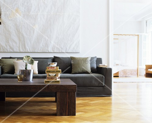 Herringbone Parquet Floor Coffee Table And Taupe Couch In Living Room