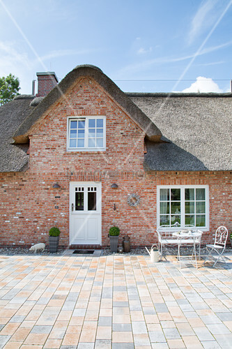 Traditional Nordic brick house with thatched roof