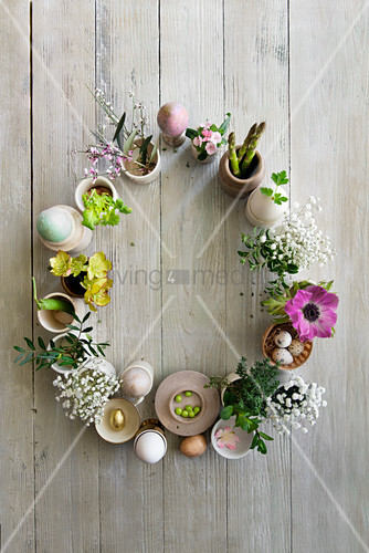 Flowers, vegetables and eggs arranged in a circle as Easter decoration