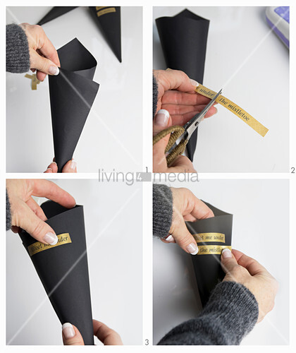 Instructions for making black paper cone with message on stickers