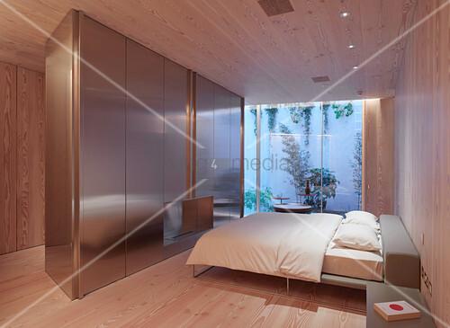 Minimalistisches Schlafzimmer mit Raumteiler