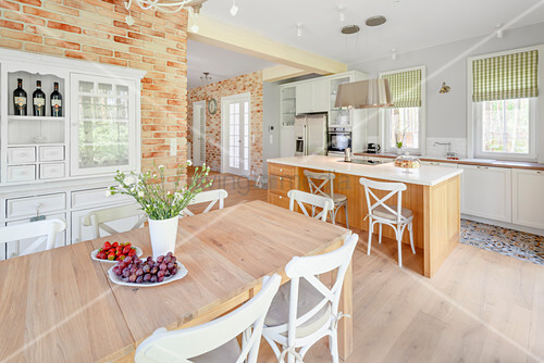 Dining table in open-plan, country-house-style kitchen
