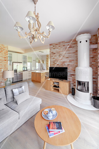 Modern open-plan, country-house-style interior with tiled stove