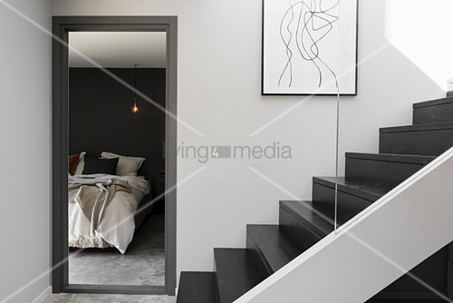 Doorway to bedroom next to staircase in black and grey
