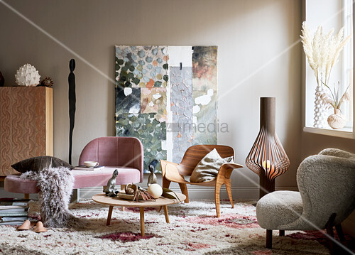Designer chairs with organic forms, couch and coffee table
