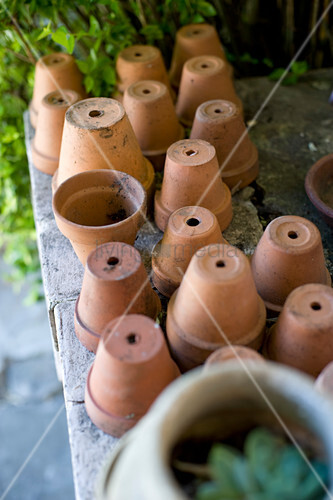 Upturned terracotta plant pots in garden