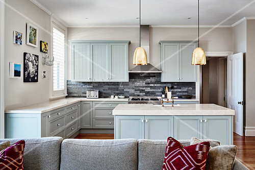Open-plan country-house kitchen with pale blue cupboards