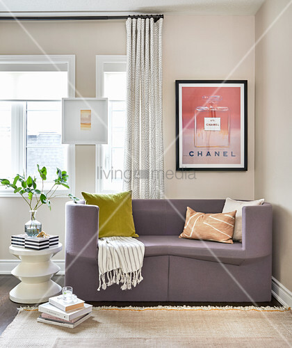 Brilliant Purple Sofa Below Framed Advert And Buy Image 12672159 Theyellowbook Wood Chair Design Ideas Theyellowbookinfo