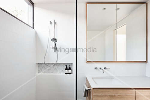 Clear lines and square mirror in modern bathroom