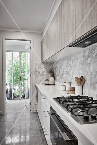 Modern kitchen in shades of grey and white with garden access