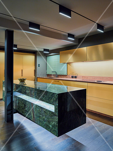 Designer kitchen with marble counter in open-plan interior