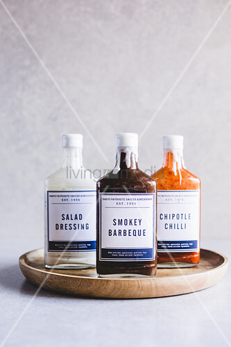 Old glass bottles with new labels for sauces