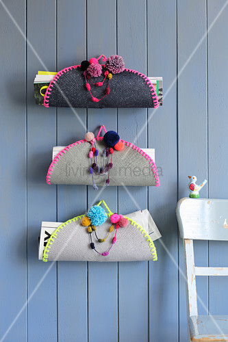 Folk-style magazine rack made from decorated place mats