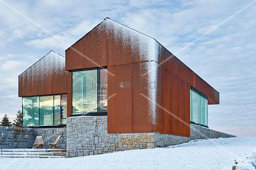 Modern, architect-designed house dusted with snow