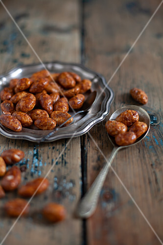 Caramelised nuts on silver plate and spoon