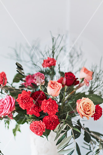 Bouquet of roses, carnations and olive branches