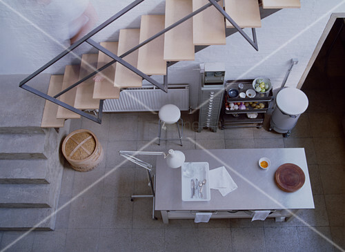 Minimalist, industrial-style kitchen seen from above