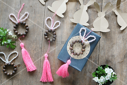 Easter bunnies made from beads with tassels and garland of paper bunnies