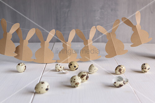 Garland of brown paper Easter bunnies and quail eggs